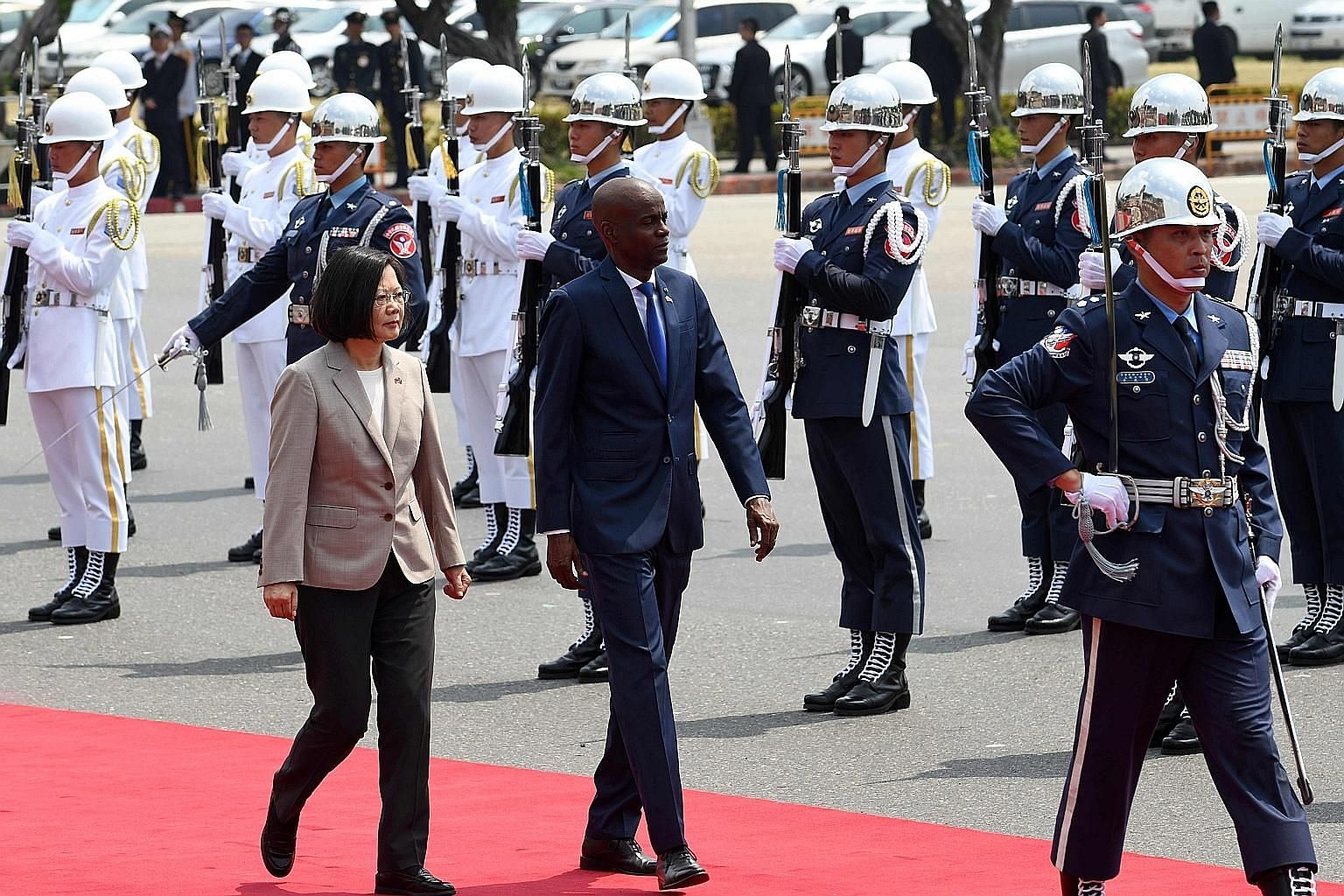 Visiting Haitian President Jovenel Moise inspecting a guard of honour, accompanied by Taiwanese President Tsai Ing-wen, during a welcoming ceremony in Taipei yesterday. Taiwan and Haiti have been allies since 1956, and there are concerns in Taipei th