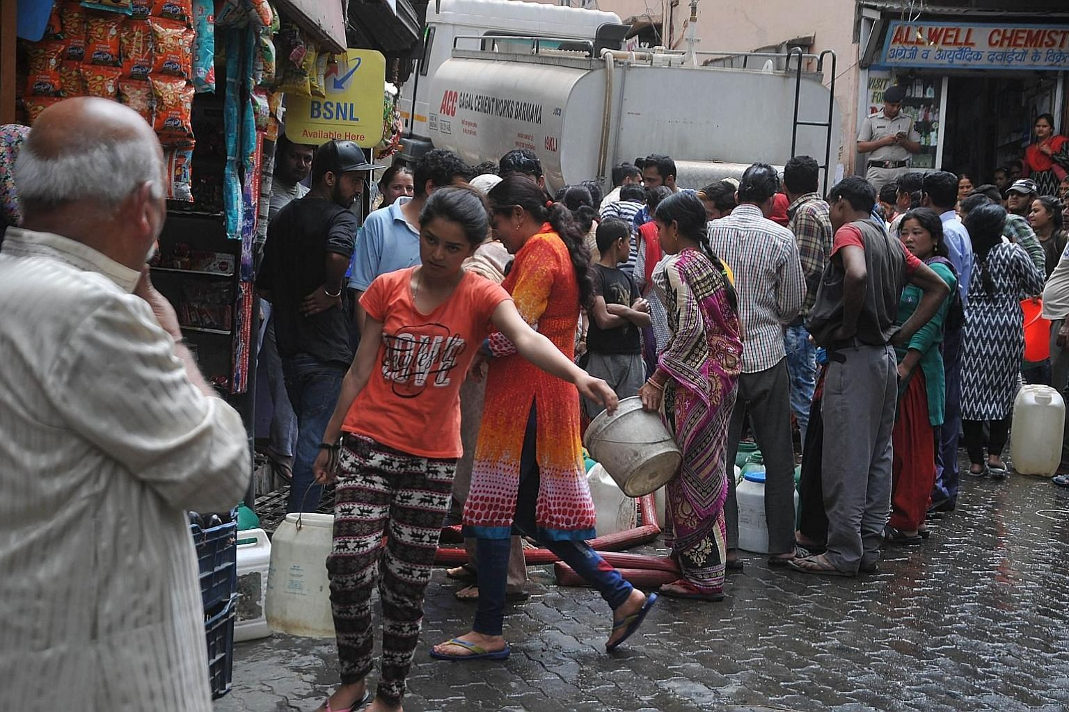 Shimla residents gathering to collect water in buckets from a water tanker yesterday. They are getting water once a week, compared with up to several times a day before the drought.