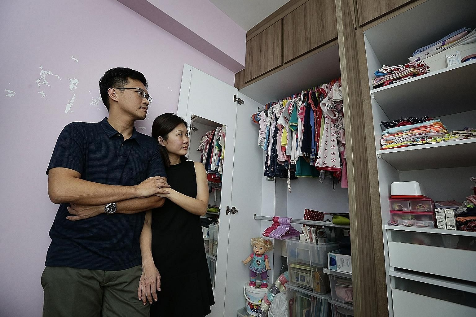 As Kaelyn's muscles wasted away, she could move only her arms. Mr Kelvin Chan and Ms Tay Shuhui with the clothes that belonged to their daughter Kaelyn, who died three years ago after her life support was withdrawn. Kaelyn was diagnosed with spinal m