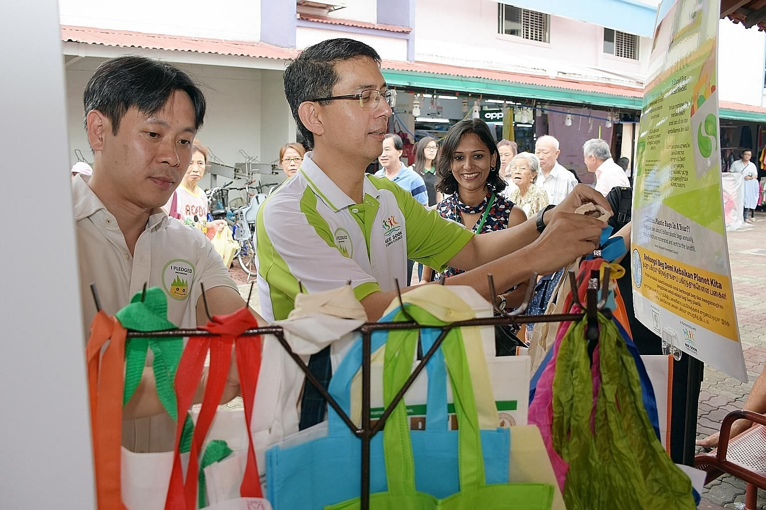 Nee Soon GRC MPs Louis Ng (left) and Faishal Ibrahim at the launch of Bounce Bags, which makes available shopping bags, such as fabric tote bags, at a designated sharing point for residents. Next to them is Ms Aarti Giri, founder of Plastic-Lite Sing
