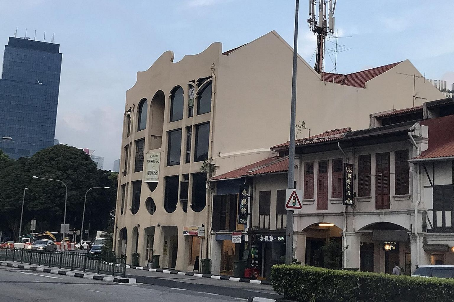 No. 13 and 15 Teo Hong Road (left) were bought by ANB Investment for close to $22 million. Separately, a four-storey freehold commercial building near the corner of Kampong Bahru Road (right) and Neil Road has been transacted for $22.58 million. The