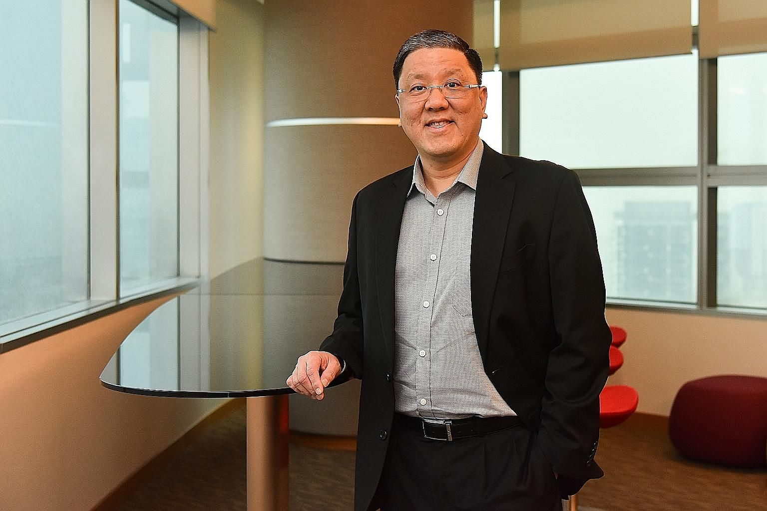 """Beneath Mr David Tan's jovial and disarming persona lies a stone-cold resolve to see projects through. His mantra, which he recites in a formulaic manner a few times during the interview, is: """"Vision, will, passion and perseverance."""""""