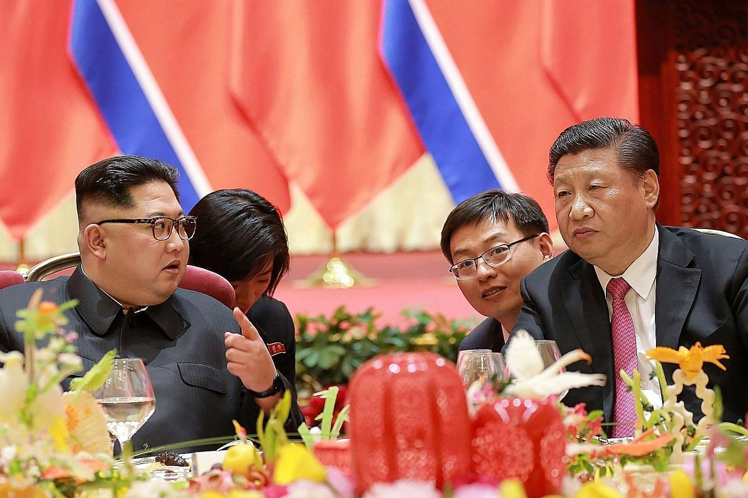 Mr Kim Jong Un with Chinese President Xi Jinping at a banquet in the city of Dalian during the North Korean leader's visit to China on May 7. The writer says China has always been, and always will be, a pushing hand behind the resolution of the Korea