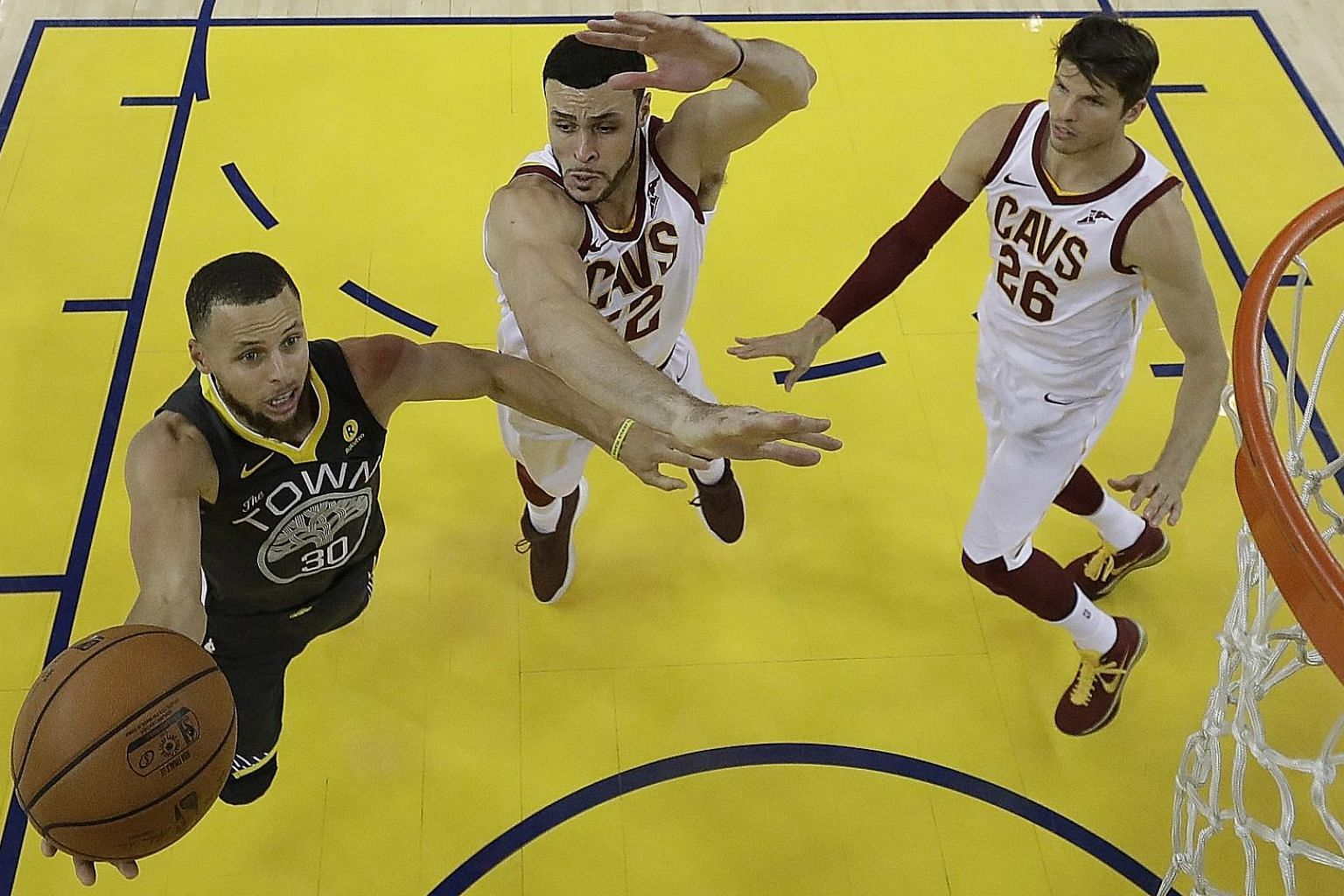 Stephen Curry of the Golden State Warriors driving to the basket against Larry Nance (No. 22) and Kyle Korver of the Cleveland Cavaliers in the second half of Game Two of the NBA Finals on Sunday. Curry finished with 33 points, converting nine of 17