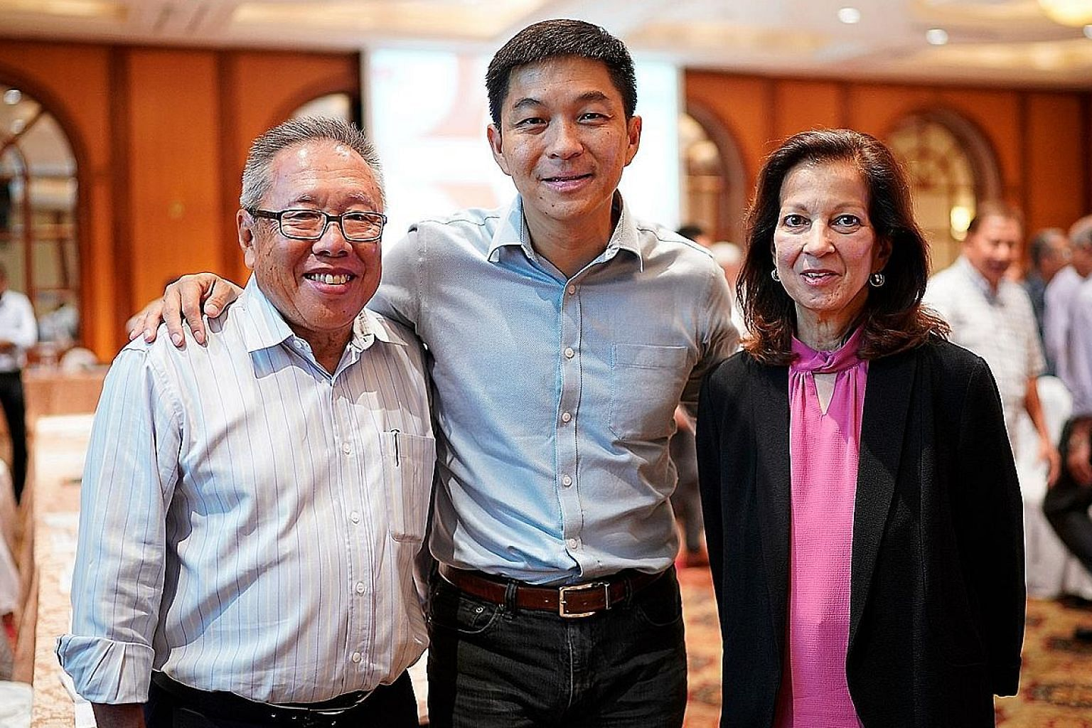 Singapore National Olympic Council president Tan Chuan-Jin (centre) with outgoing vice-presidents Low Teo Ping and Annabel Pennefather at the AGM.