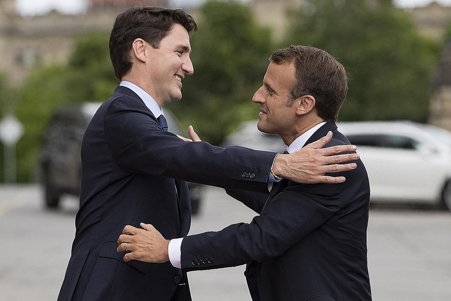 Canadian Prime Minister Justin Trudeau (left) greeting French President Emmanuel Macron as he arrived at Parliament Hill in Ottawa, Canada, on Wednesday. Mr Trudeau has slammed US President Donald Trump's tariffs on Canadian steel and aluminium, whil
