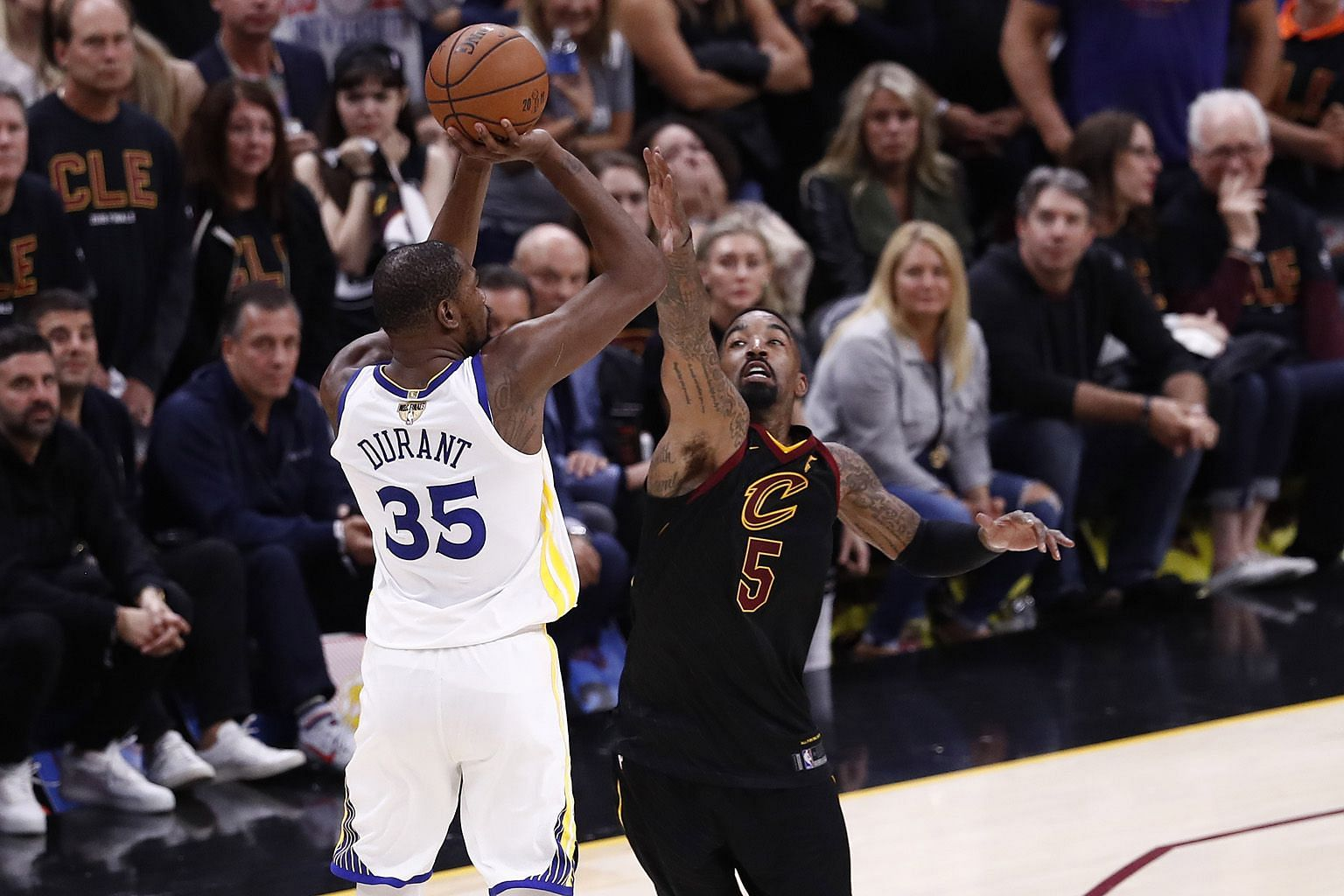 Golden State forward Kevin Durant shooting the crucial three-pointer over Cleveland guard J.R. Smith with under a minute left of Game 3 in the NBA Finals. His heroics were sorely needed as the Warriors' second-highest scorer Stephen Curry had only 11