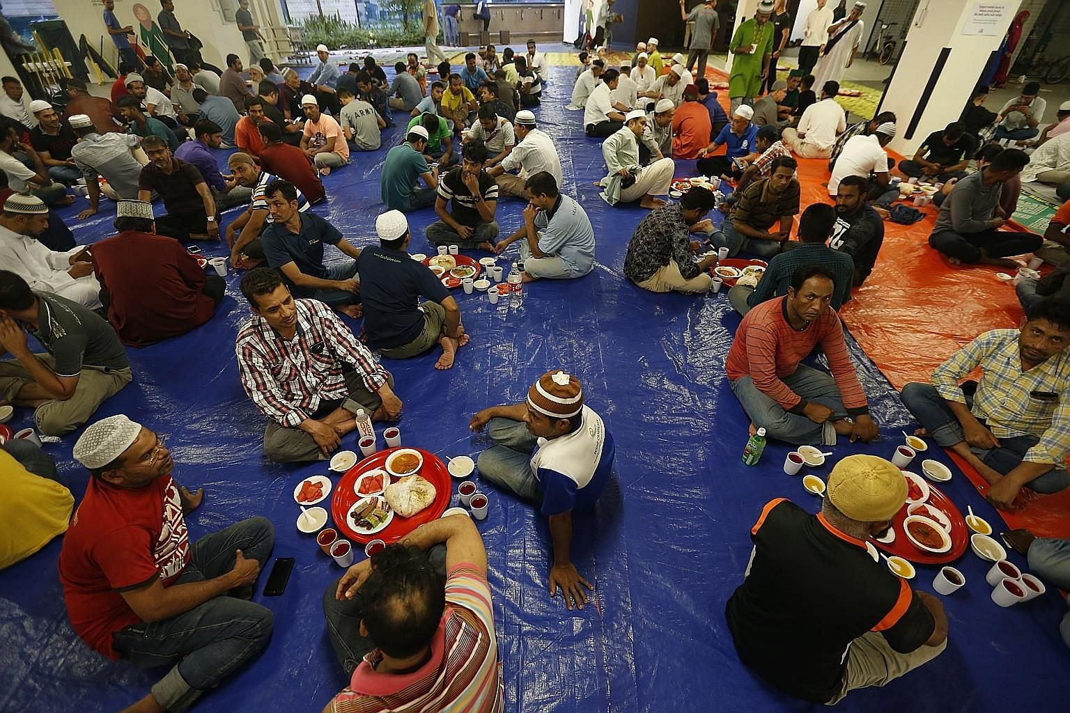 Though more than 200 migrant workers break their fast at the Yusof Ishak mosque every day, yesterday marked the first time workers were formally invited to the mosque in Woodlands. Invitations were sent out to them in Bengali, Tamil and Hindi. The ev