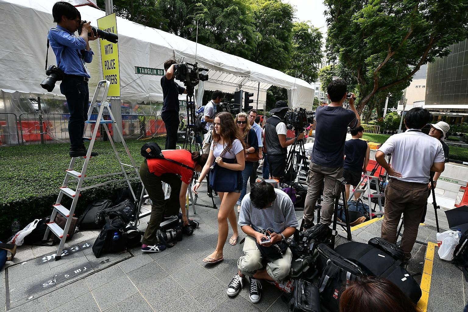 Media members yesterday staking out Tanglin Place, opposite The St Regis Singapore, where North Korean leader Kim Jong Un is staying.