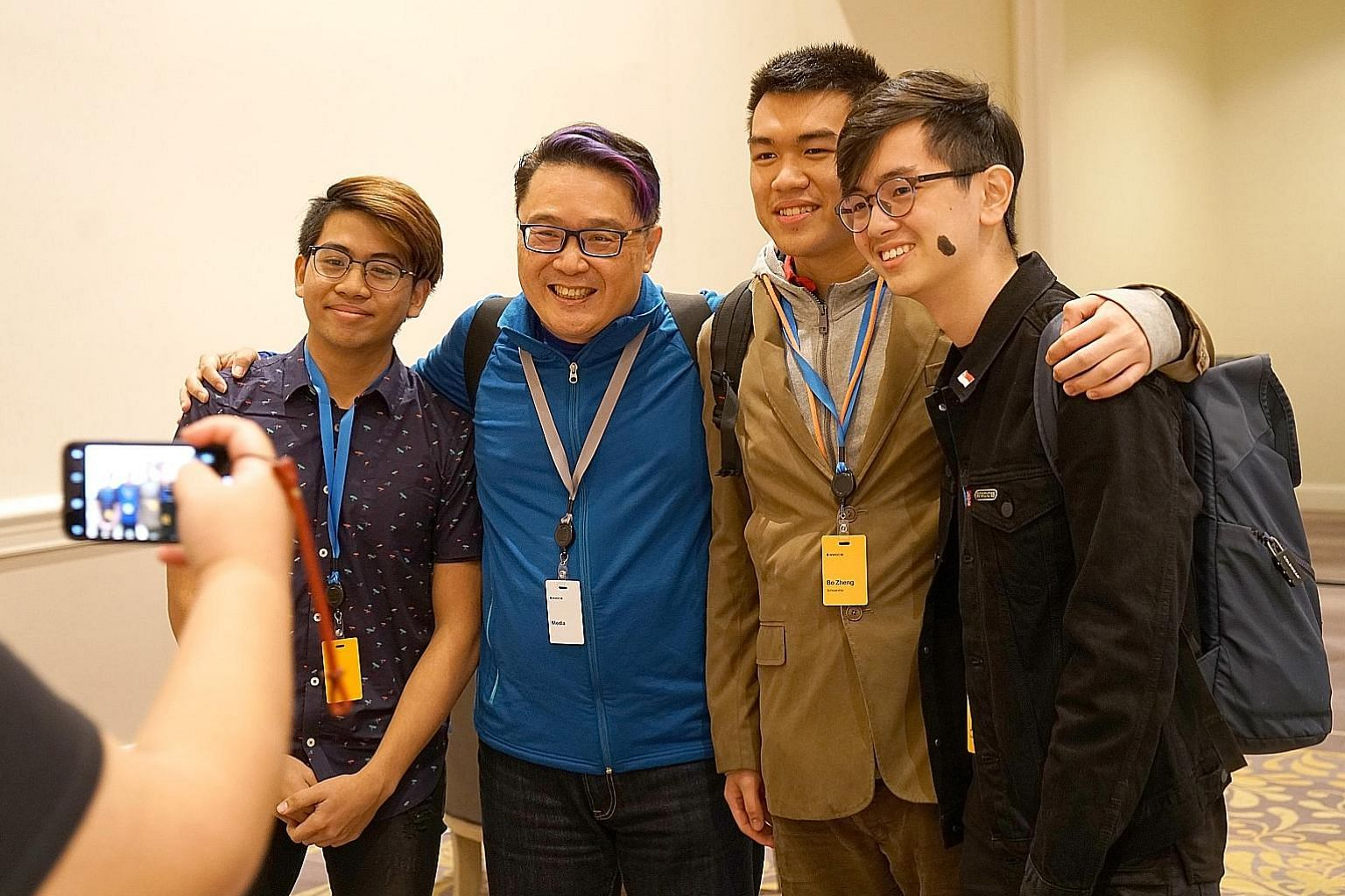 Singapore blogger Mr Brown (in blue) with (from left) young developers Dalton Ng, Zhang Bozheng and James Lim, who attended the Worldwide Developers Conference (WWDC) under Apple's WWDC Scholarships scheme.