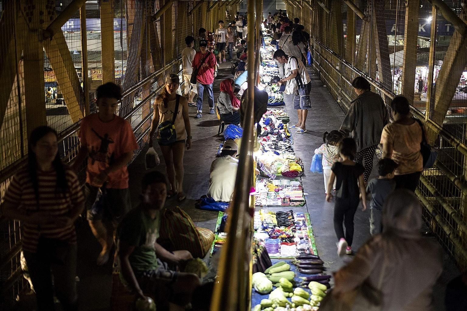 Food vendors in Manila. Philippine government figures show prices of rice, corn, fish, alcohol, tobacco and fuel have risen.