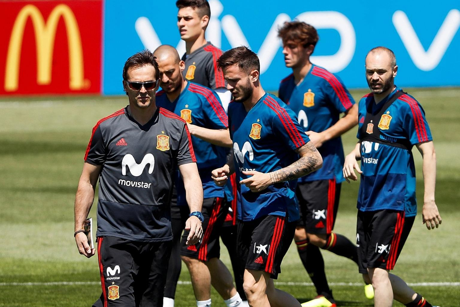 Spain head coach Julen Lopetegui (far left) during training in Krasnodar, Russia, on Tuesday - the day he was named as Zinedine Zidane's replacement at Real Madrid. Spain sporting director Fernando Hierro (above) will take charge of the national side
