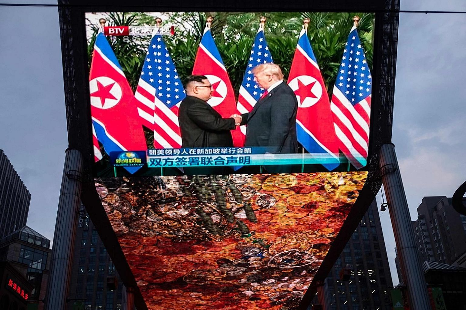 Television footage in Beijing showing North Korean leader Kim Jong Un and US President Donald Trump at their summit in Singapore on Tuesday, where they agreed on denuclearisation of the Korean peninsula and to establish new relations between the US a
