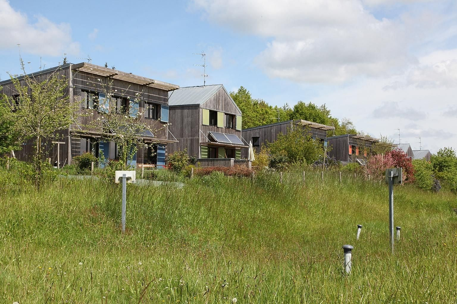 The hamlet, La Pelousiere, built in 2011, is made up of energy-efficient wooden houses equipped with solar panels.