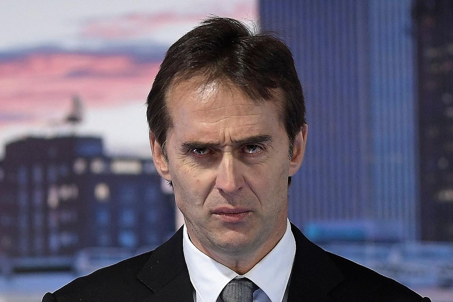 New Real Madrid coach Julen Lopetegui with tears welling up in his eyes while speaking at the Santiago Bernabeu on Thursday.