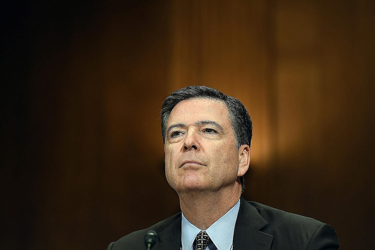 """A US Justice Department report has found that then-FBI director James Comey was """"insubordinate"""" in how he handled an e-mail probe."""