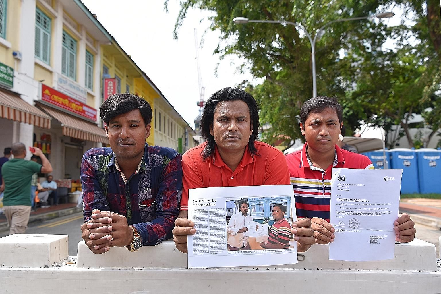 Bangladeshi workers (from left) Rabiul Islam Abdur Rahaman Mia, Alam Ataur Rahman and Islam Mohd Rubayet with copies of the ST story in 2016 on their plight and the Labour Court Order.
