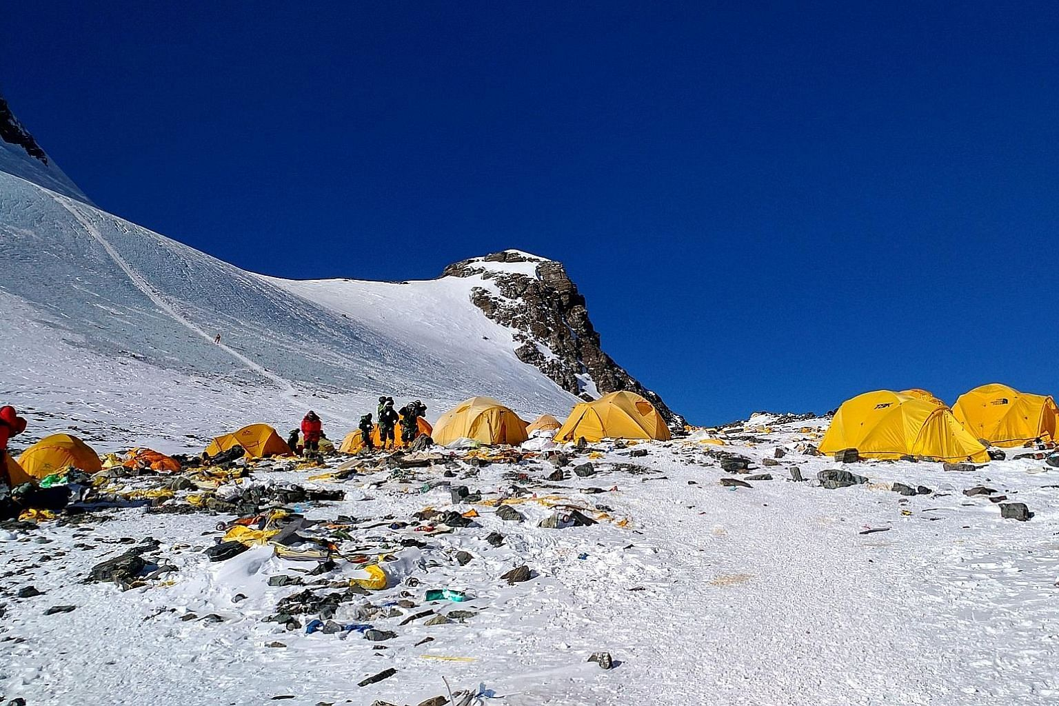Discarded climbing equipment and rubbish scattered around Camp 4 of Mount Everest, in a photo taken last month. With the number of commercial climbers soaring, the waste problem has only worsened.