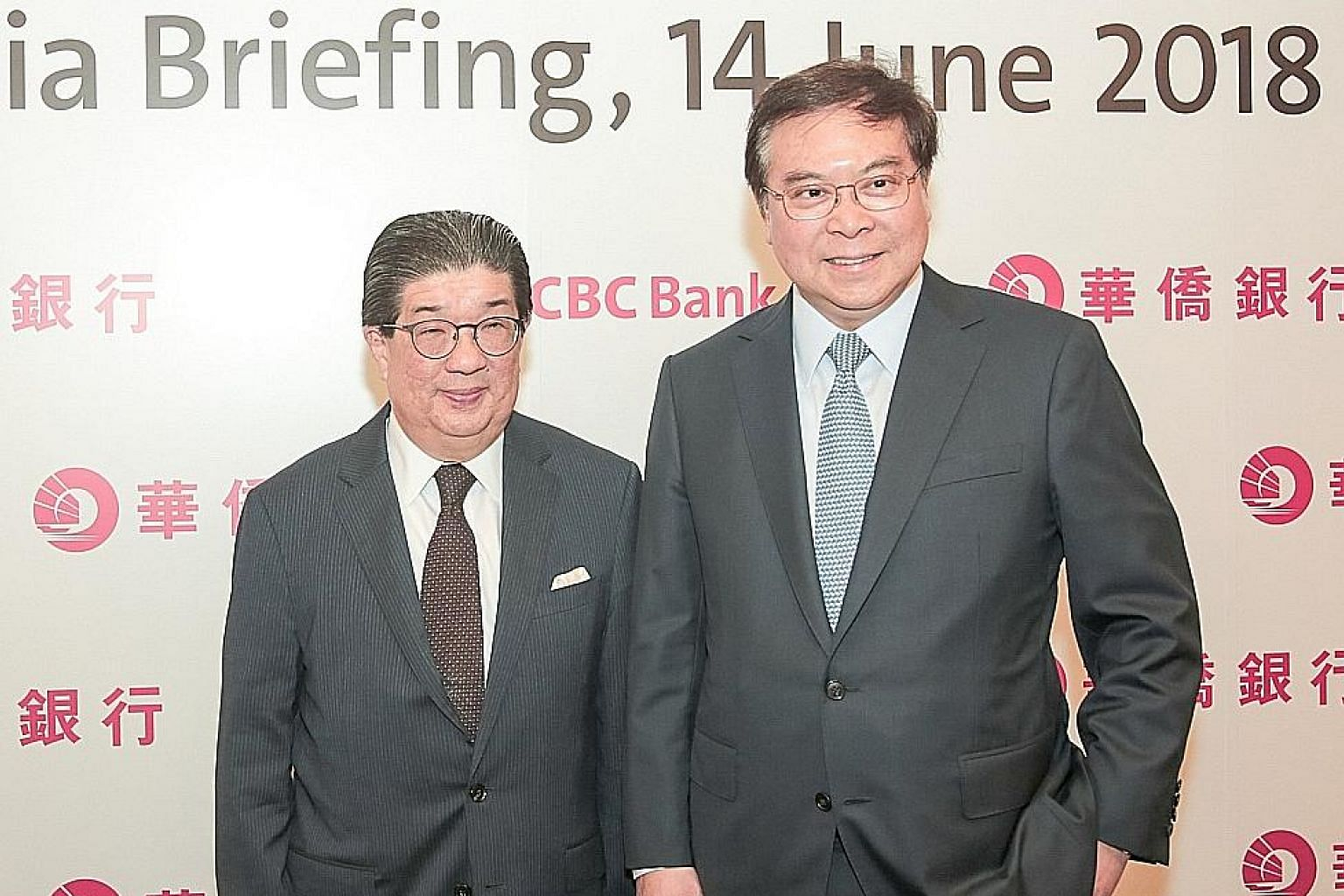 OCBC chief executive Samuel Tsien (right) with Mr Na Wu Beng, chief of subsidiary OCBC Wing Hang Bank, at a briefing last week.