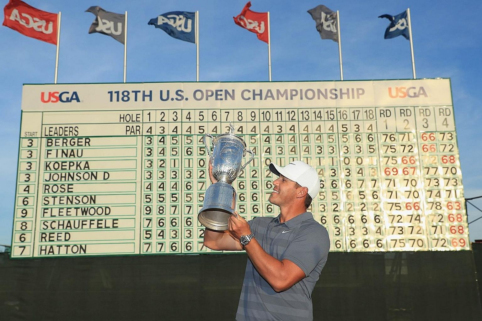 Brooks Koepka admiring the US Open trophy on Sunday. Since the World War II era, he is only the third man to retain the title, after Ben Hogan (1950-51) and Curtis Strange (1988-89).
