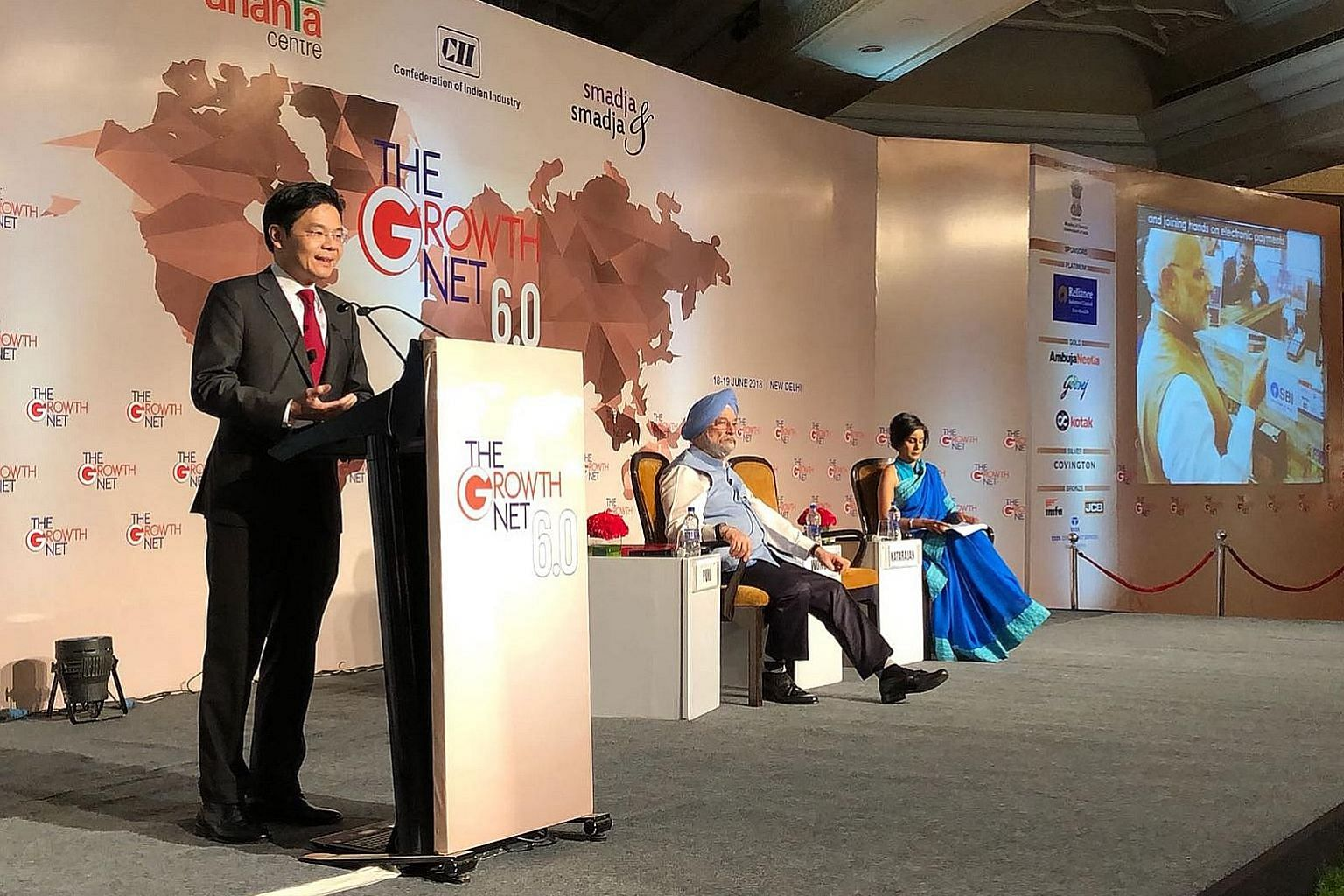 Mr Lawrence Wong speaking at the convention, sharing the stage with Mr Hardeep Singh Puri, India's minister of state for housing and urban affairs, and Ms Manisha Natarajan, the moderator.
