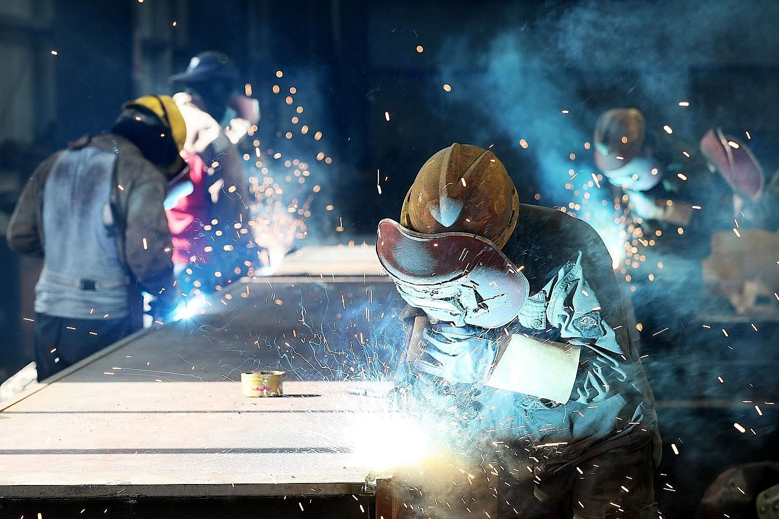 A worker cutting steel at a factory in Huaibei, in China's Anhui province. US President Donald Trump's threat of additional tariffs on US$200 billion (S$272 billion) worth of Chinese goods comes after the US announced 25 per cent additional tariffs o