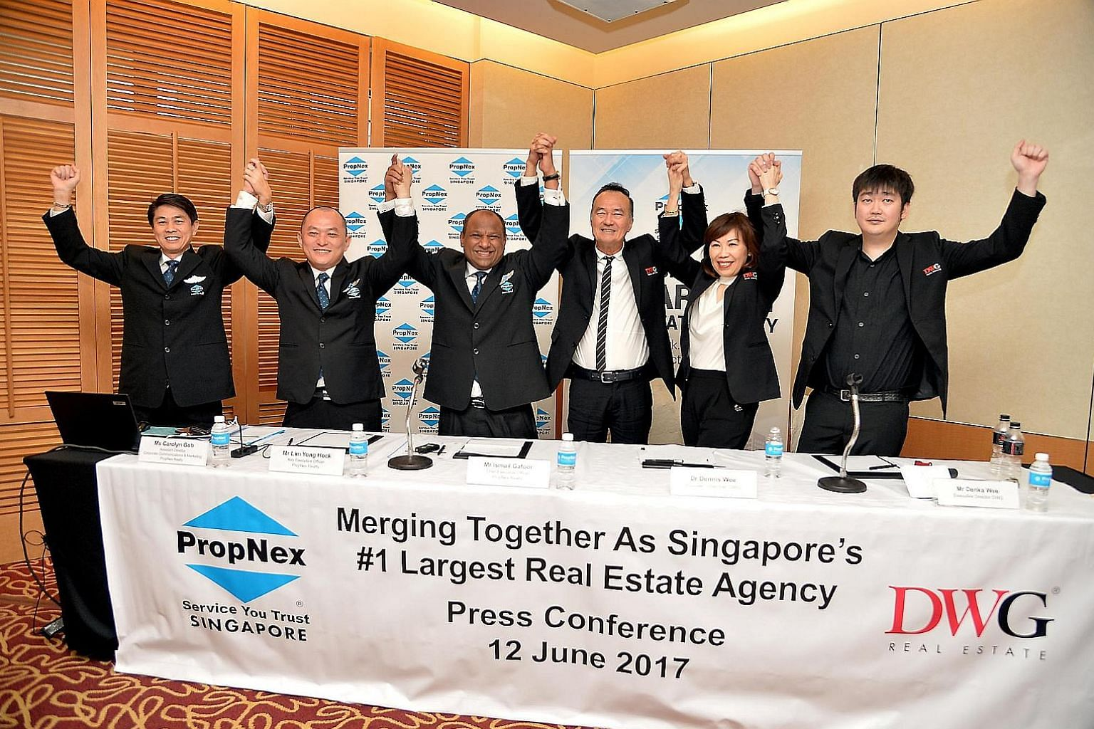 Celebrating the merger of their companies on June 12 last year were (from left) PropNex's director Alan Lim, key executive officer Lim Yong Hock, and CEO Ismail Gafoor, Dennis Wee Realty's founder Dennis Wee, its director Priska Wee, and executive di