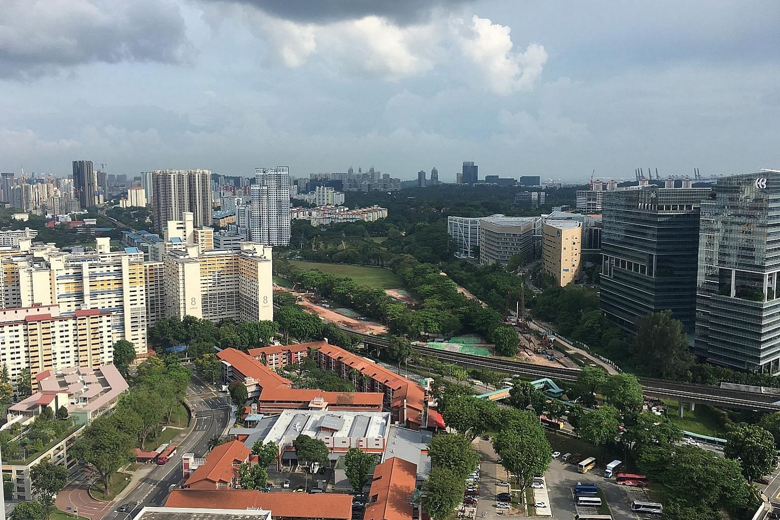 Above: The five-room HDB resale flat sold for $1.1 million is on the 38th floor of Block 18C in Holland Drive. Left: The view from the 38th floor of Block 18C.