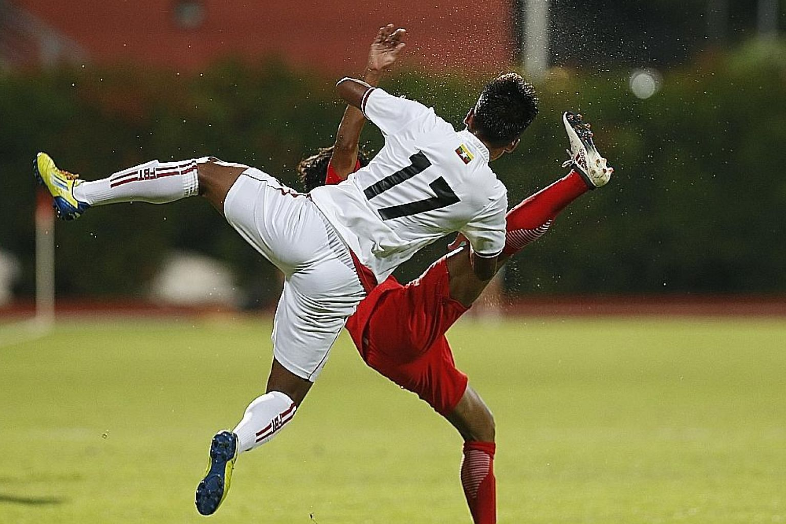 Myanmar defender Nyein Chan Aung (No. 17) making his presence felt at Bishan stadium yesterday. Myanmar, with an average age of 18, beat the Young Lions 2-0 in a friendly.