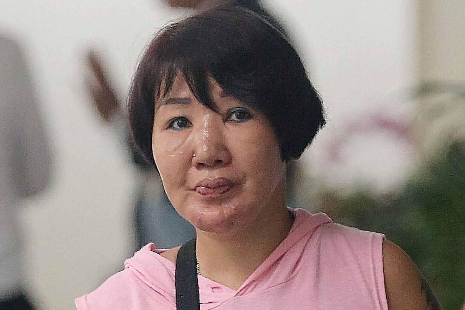 Ms Wendy Tan Li San suffered second-degree burns after her former husband poured hot water on her.