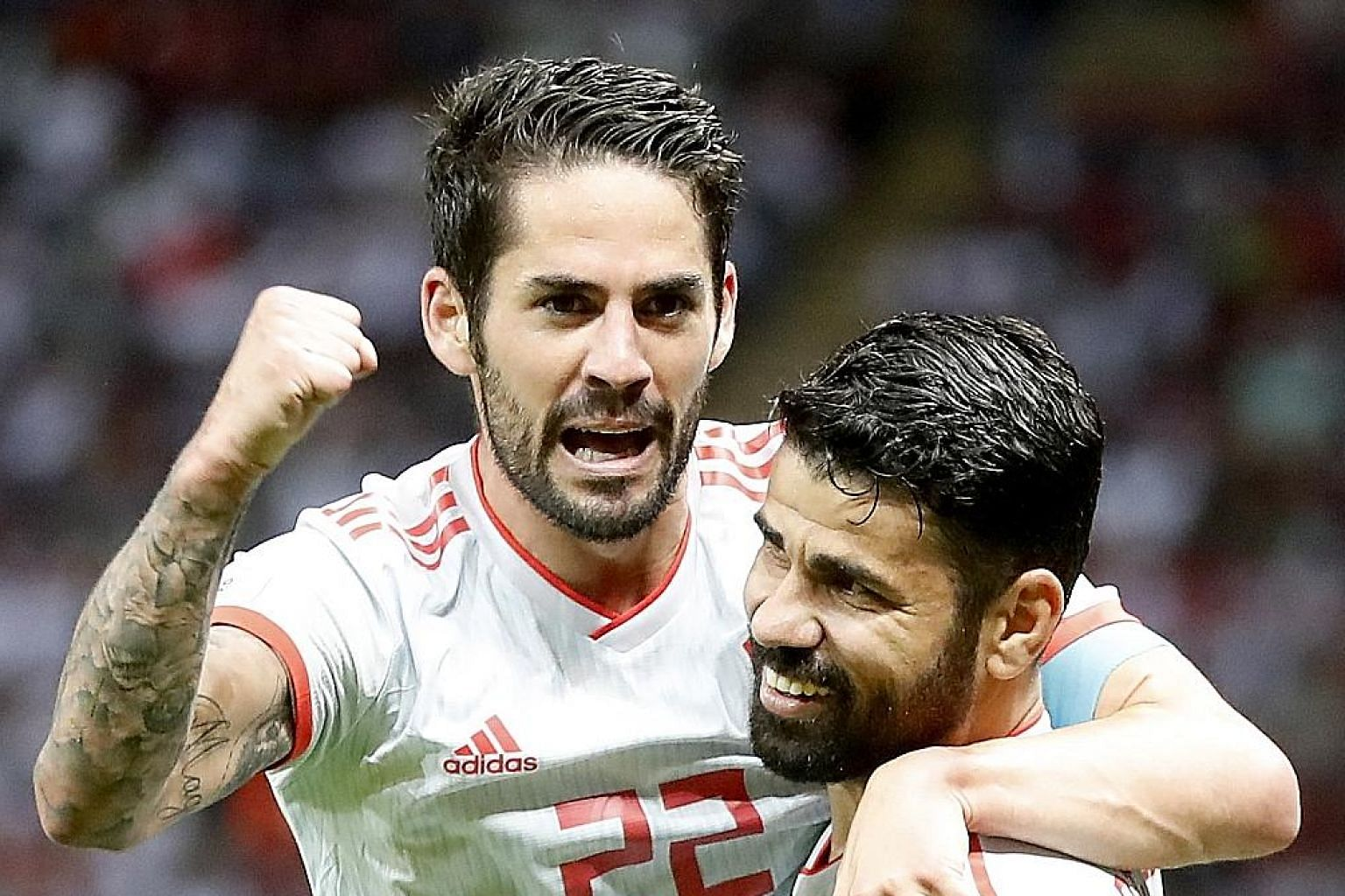 Diego Costa (right) celebrating with Spain team-mate Isco after scoring the only goal of the World Cup match against Iran on Wednesday.