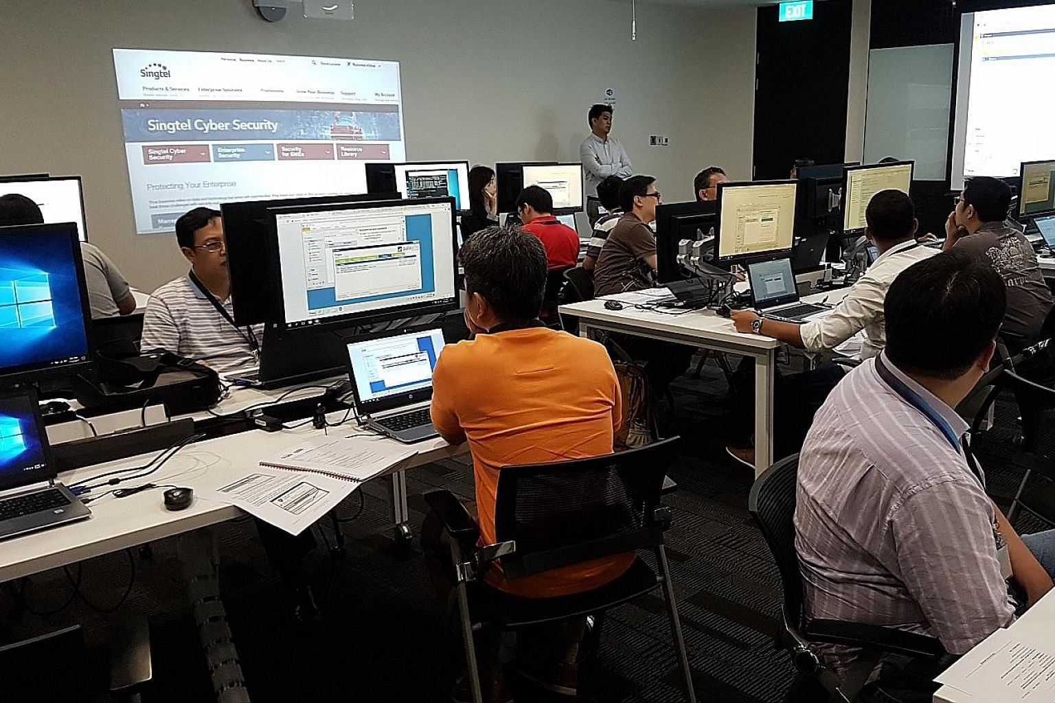"The Singtel Cyber Security Institute which trains technical professionals and management personnel to handle cyber breaches. The telco has 10 ""advanced security operation centres"" across the Asia-Pacific, Europe and the Americas, and about 2,000 cybe"