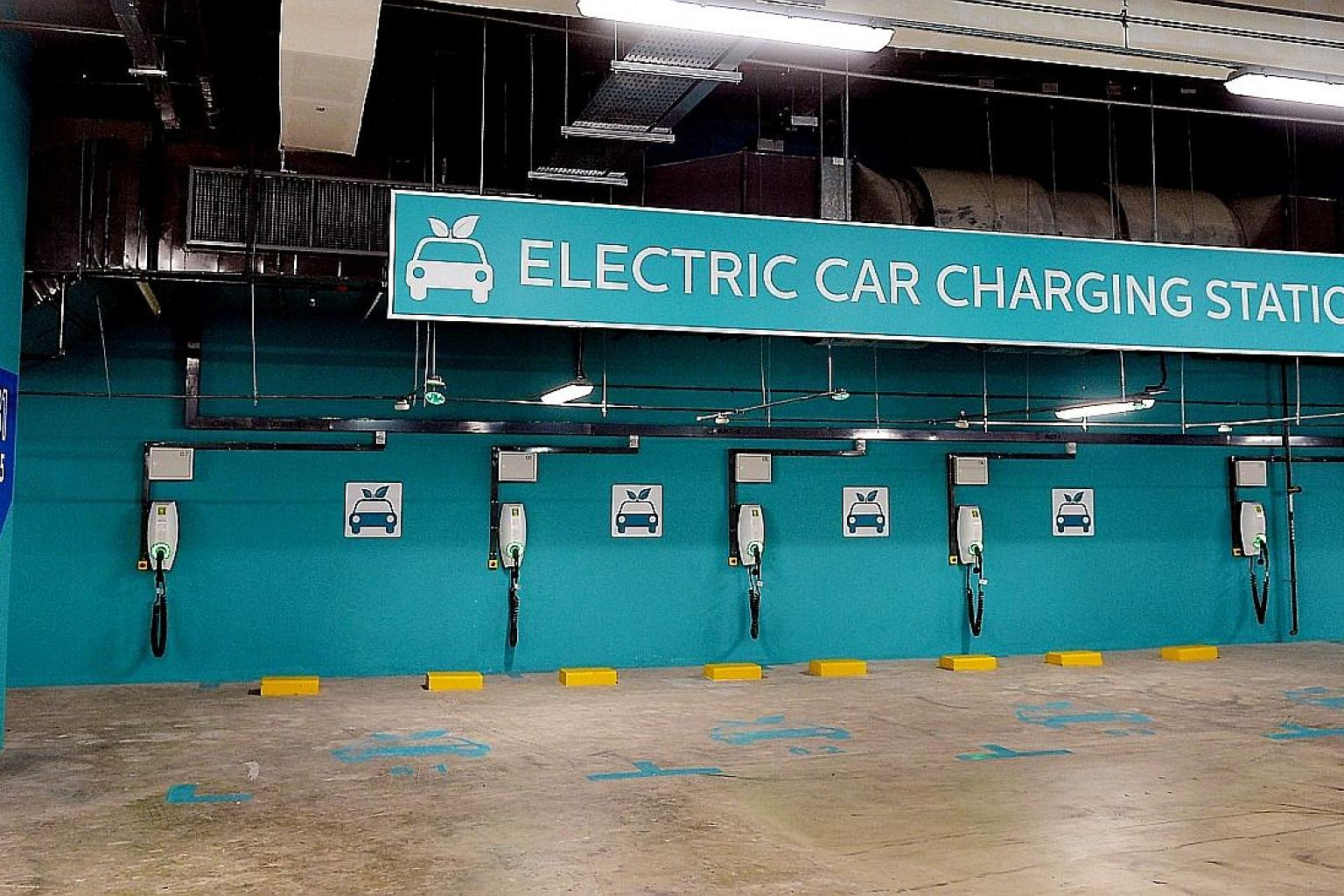 The electric car charging stations at Our Tampines Hub. Land Transport Authority figures show the number of fully-electric and plug-in hybrid cars growing from 137 two years ago to 592 as of April.