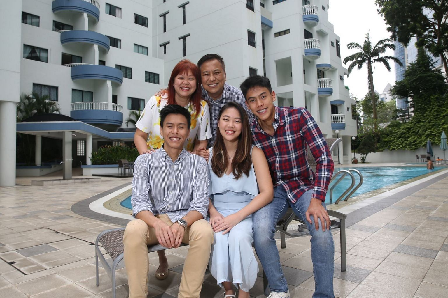 Financial adviser Bernard Lim with his wife Caron and three children – (from left) Isaac, Rachel and Joshua. Much of Mr Lim's time and resources are spent on his business, Wealth College. Over the next five years, he plans to equip more practitioners to s