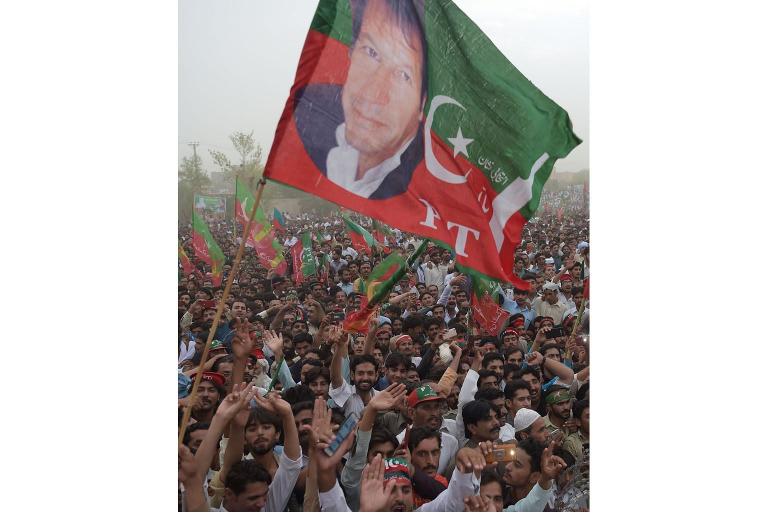 Supporters of Pakistani politician Imran Khan at an election campaign this month. Many believe Mr Khan is in line for elevation to prime minister with the security establishment's support.