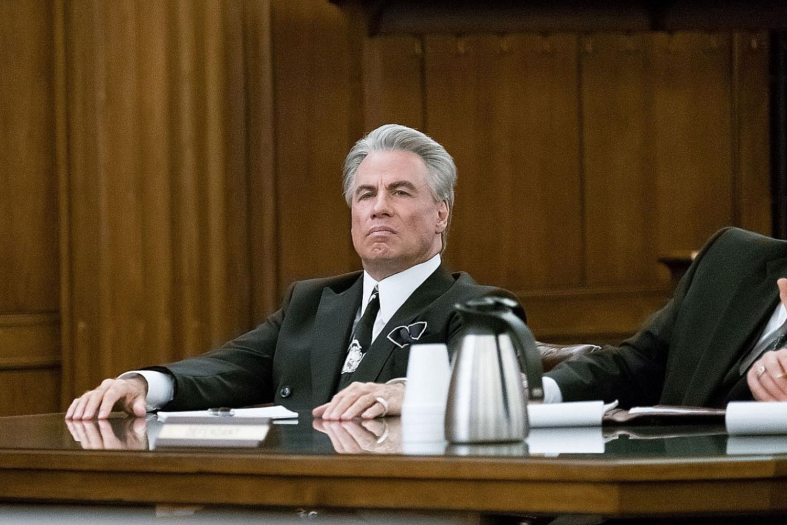 The biopic of John Gotti (John Travolta, above) begins near the end of the mob boss' life.