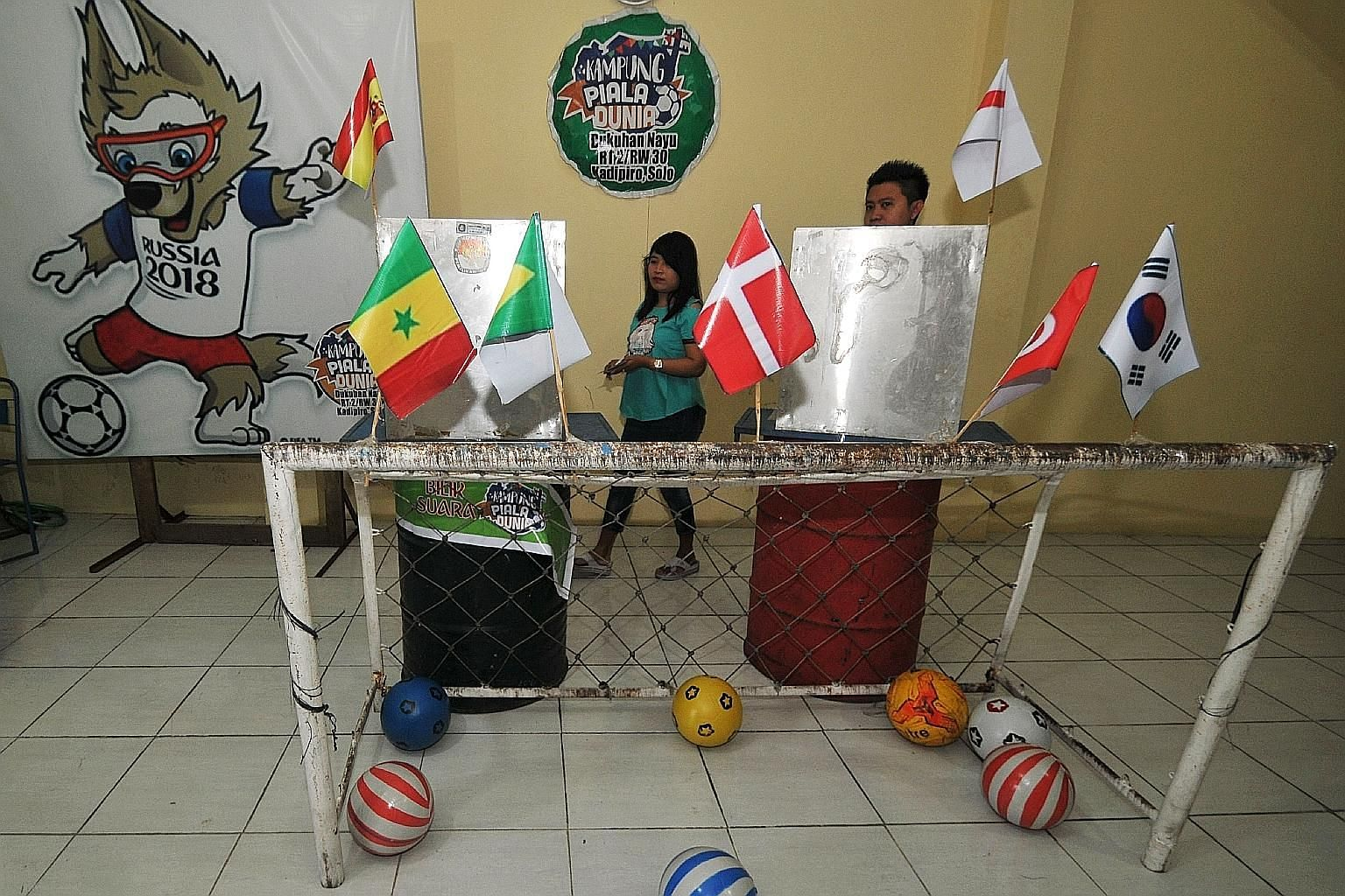A polling station in Solo, Central Java, decorated with a football theme amid the ongoing World Cup in Russia. Over 150 million registered voters were set to elect their governors, mayors and regents in yesterday's polls.