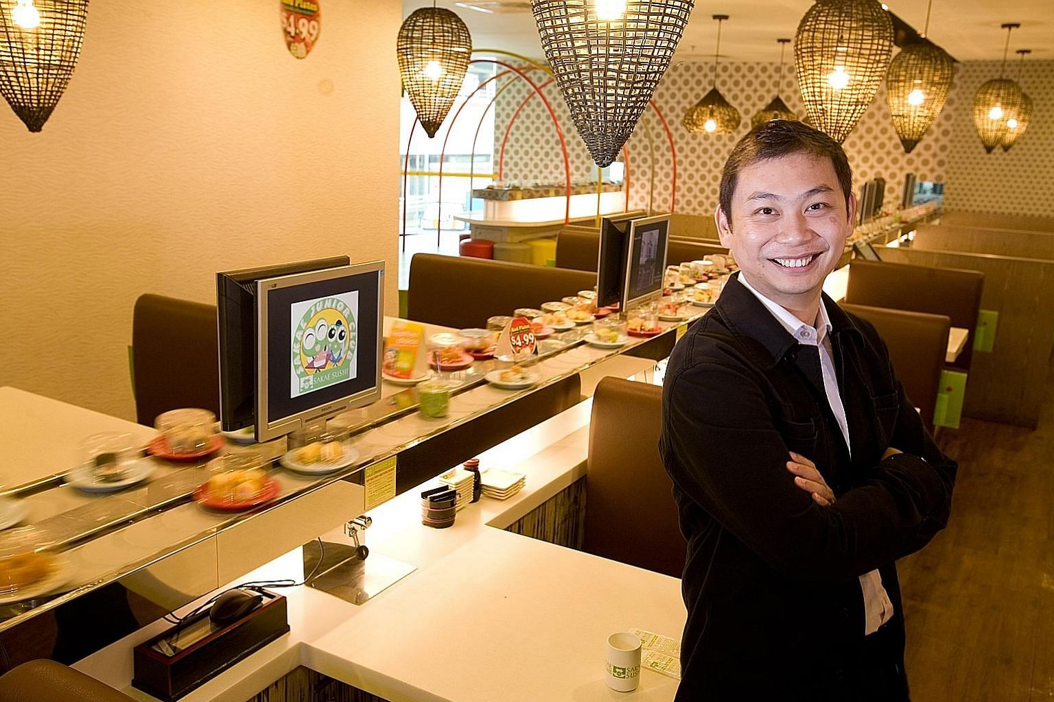 """Sakae Sushi founder Douglas Foo (above) said the legal spat """"hugely impacted"""" how the company had performed in recent years. Chief Justice Sundaresh Menon, in a judgment delivered yesterday, said Mr Andy Ong (below) was """"the key figure behind all the"""