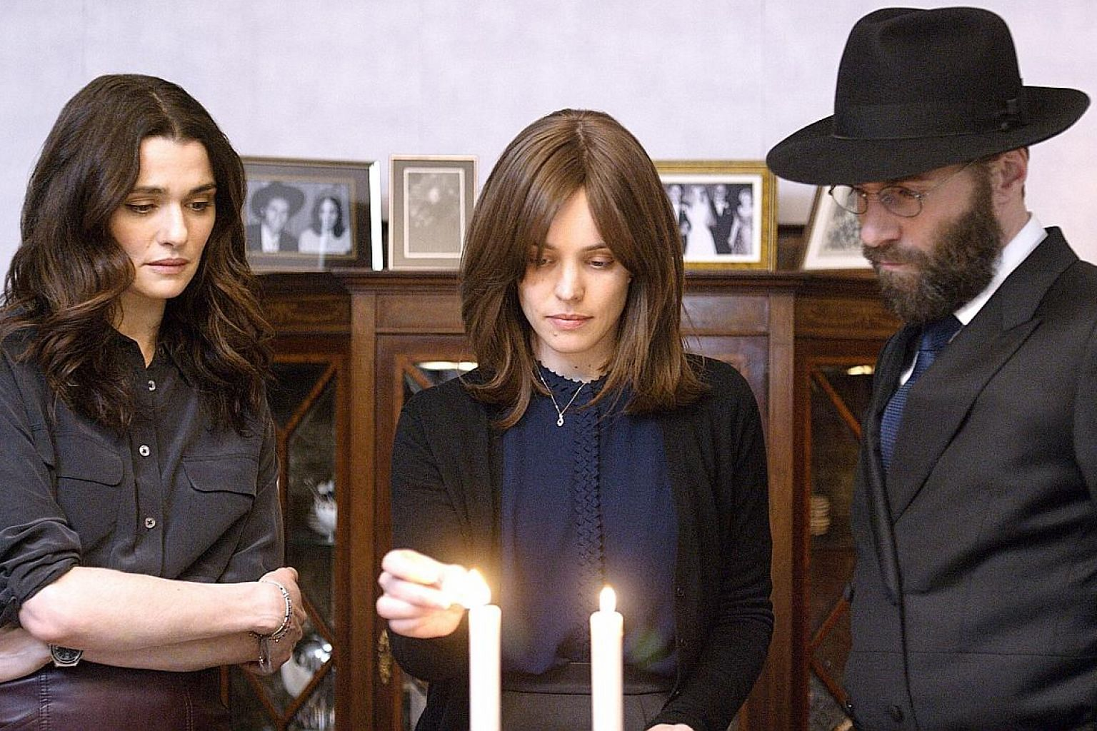 From left: Rachel Weisz, Rachel McAdams and Alessandro Nivola in Disobedience.