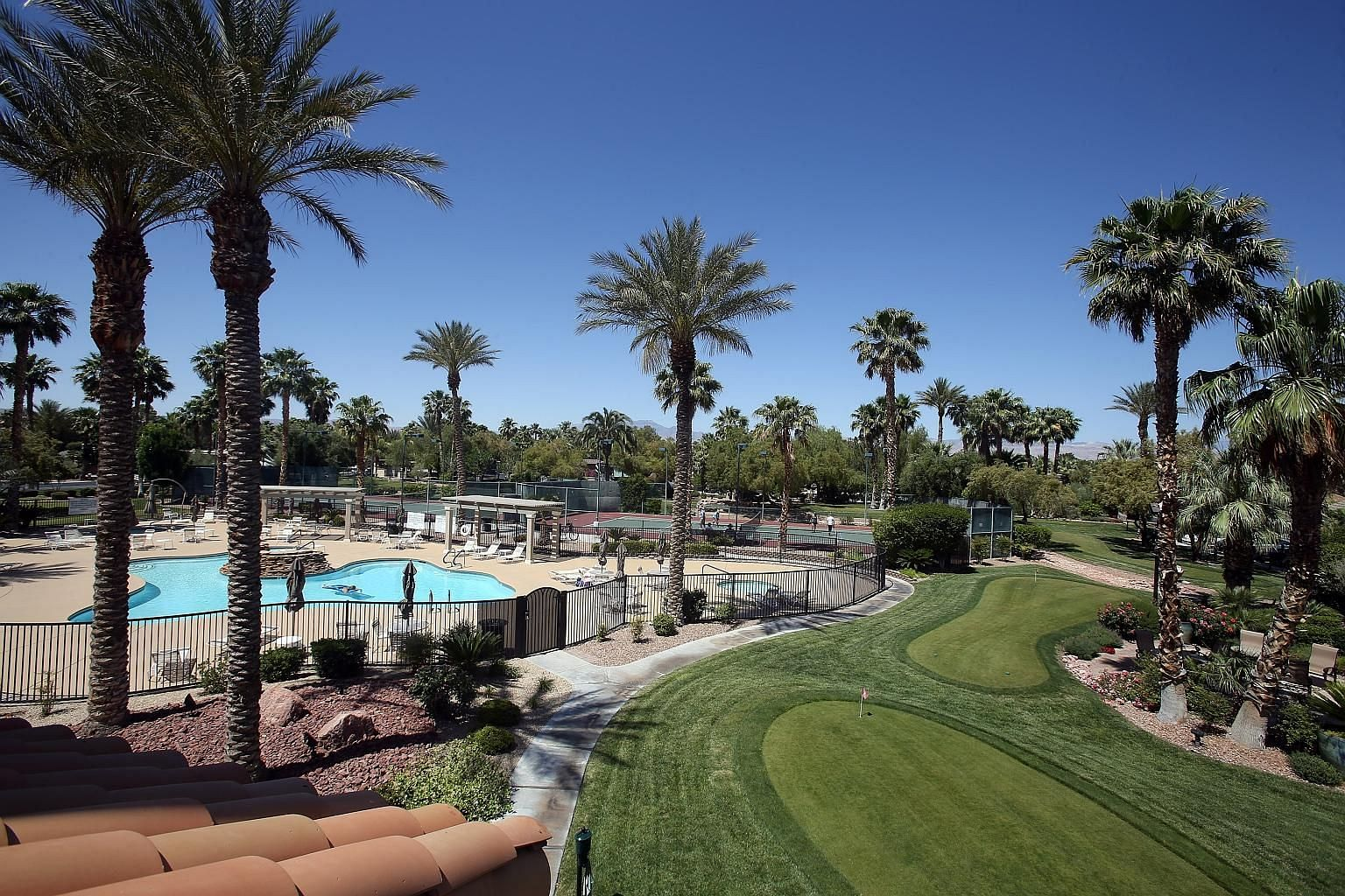 The luxurious Las Vegas Motorcoach Resort (above), where married couple Margie and John Stites (above left) have parked their motor home, comes with pools and a nine-hole putting course.