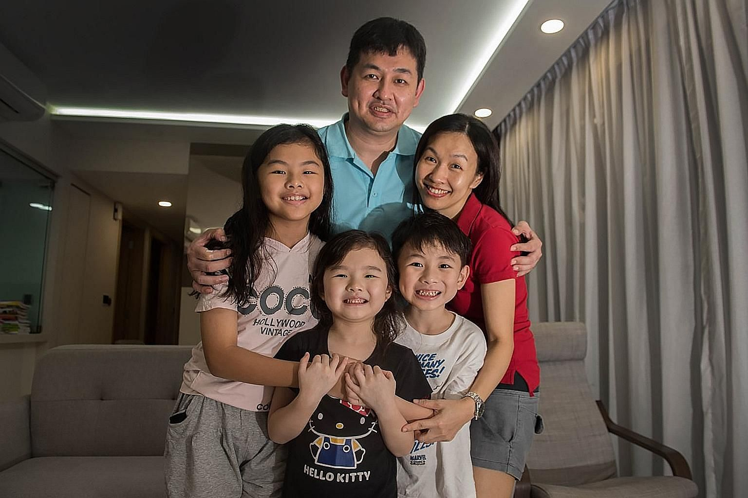Mr Bryan Lee Ooi Chiang and his wife Lee Ah Nee with their children (from left) Cherise, Celeste and Kayson. Six-year-old Celeste will be joining her older siblings in Chong Fu Primary School in Yishun next year. Mrs Lee says she hopes this will mean