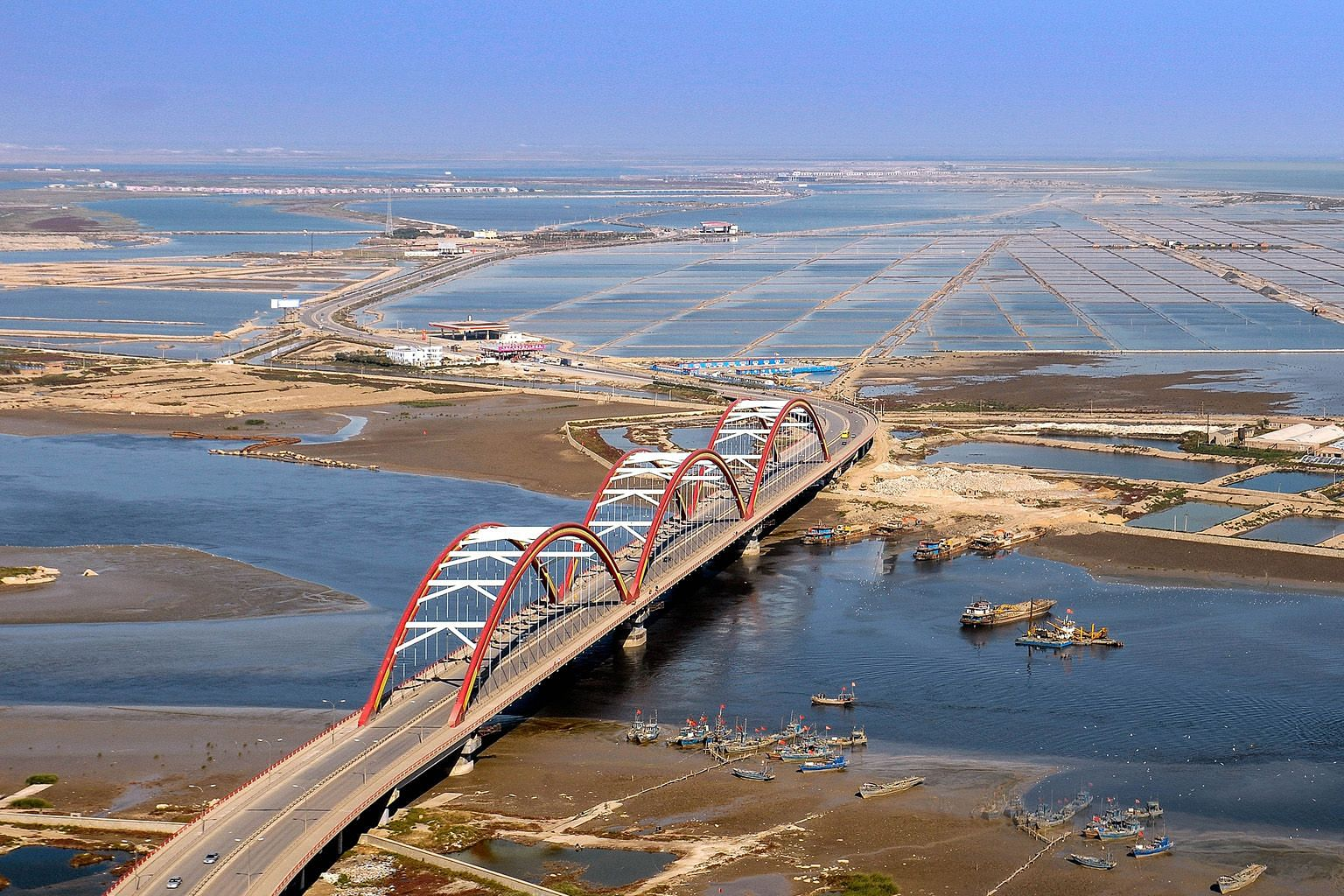 The eco-city last year, after the bilateral project turned the barren wasteland into a thriving township that emphasises a low-carbon, green lifestyle. The approach to Tianjin Eco-city from the Rainbow Bridge in the Tianjin Binhai New Area in 2008, b