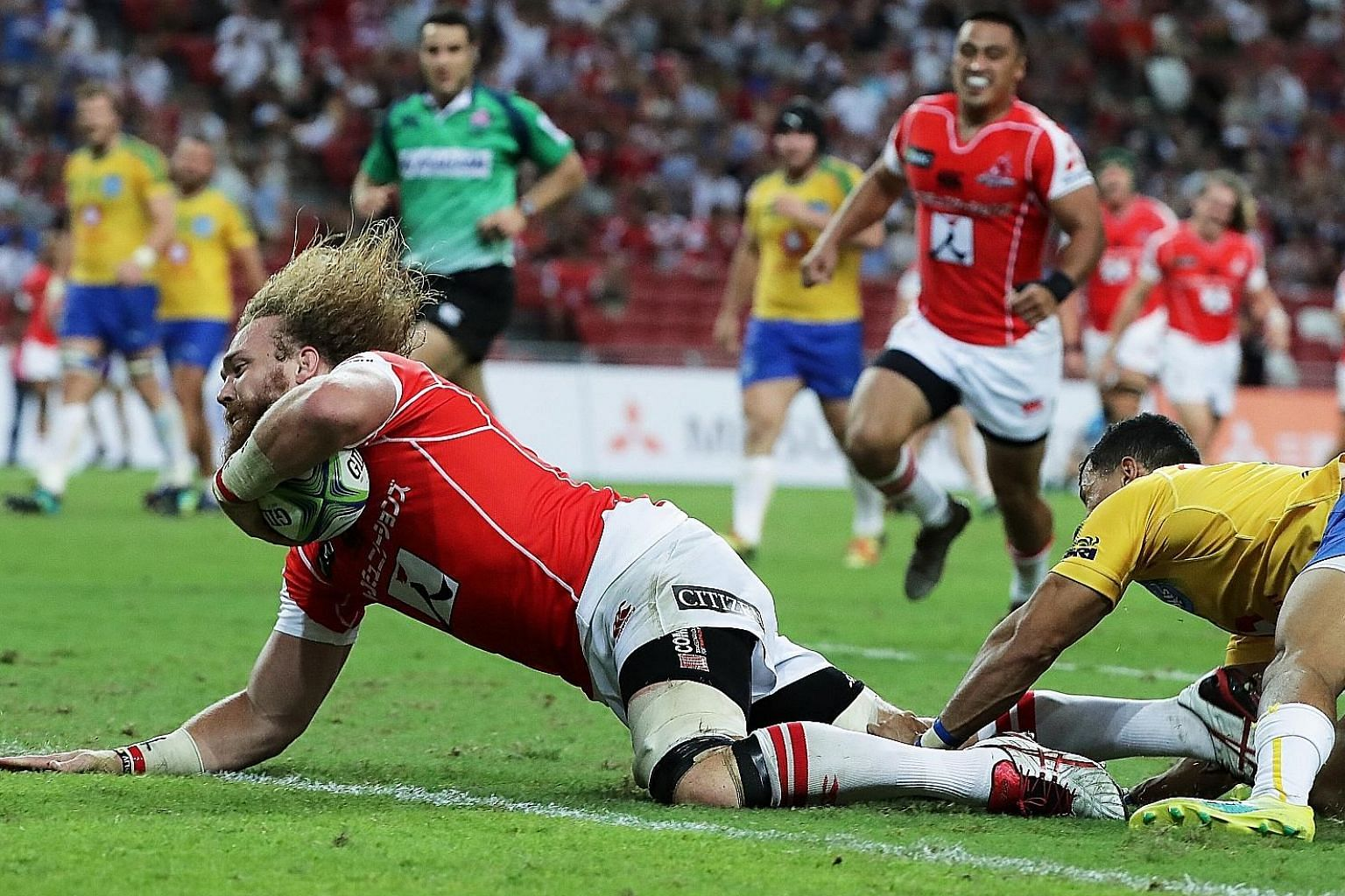Sunwolves captain and flanker Willie Britz scoring a try during their third win of the year last night at the National Stadium - the most in any Super Rugby season.