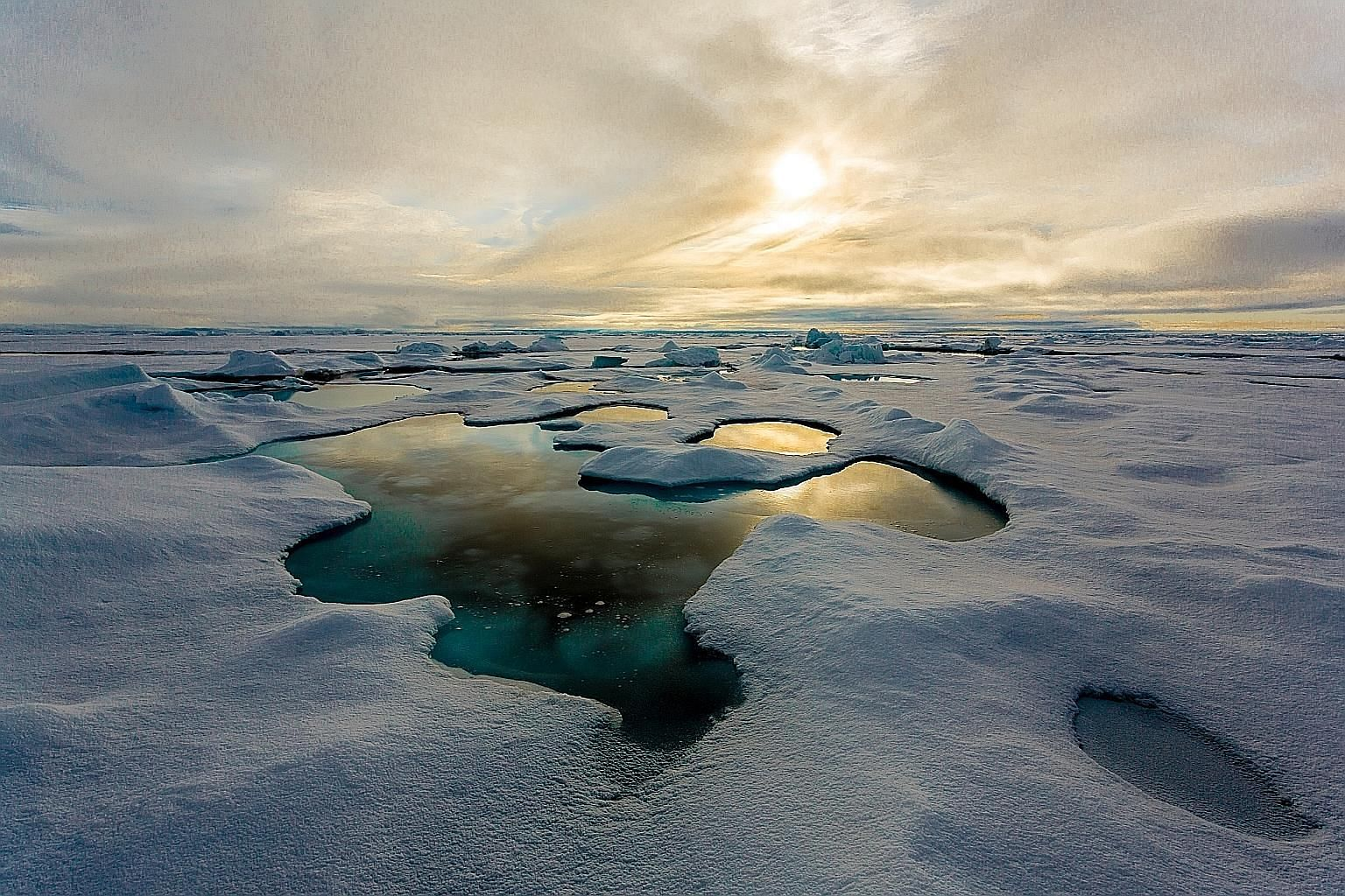 Ponds of melt water on sea ice in the Central Arctic region.