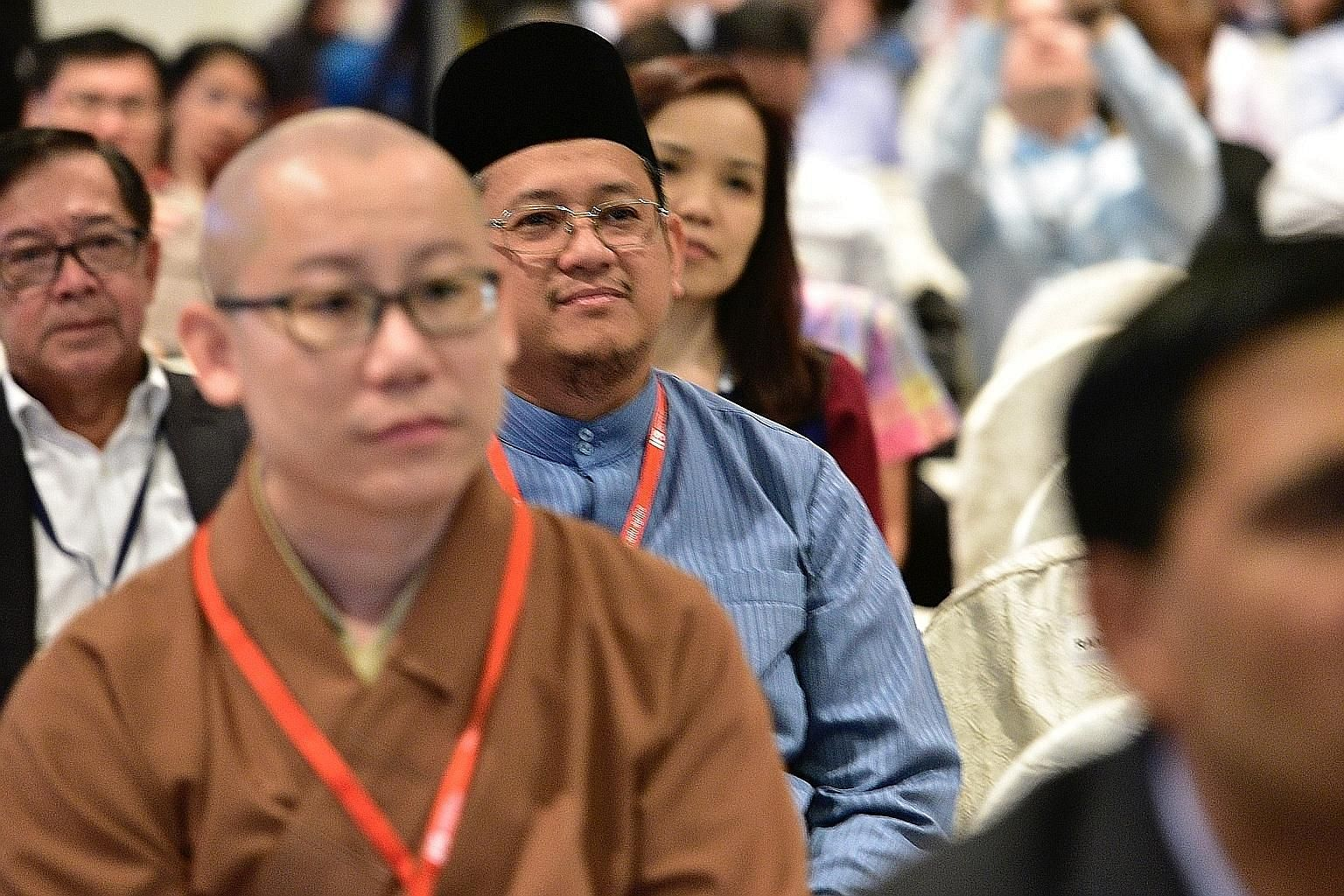 Mufti Fatris Bakaram (centre) at the Institute of Policy Studies forum, which focused on the role of the state and of religious leaders in fostering religious harmony in Singapore.