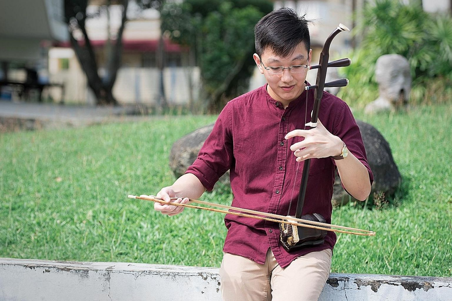 Freelance composer Phang Kok Jun, 29, playing the erhu. He started composing music while serving NS.