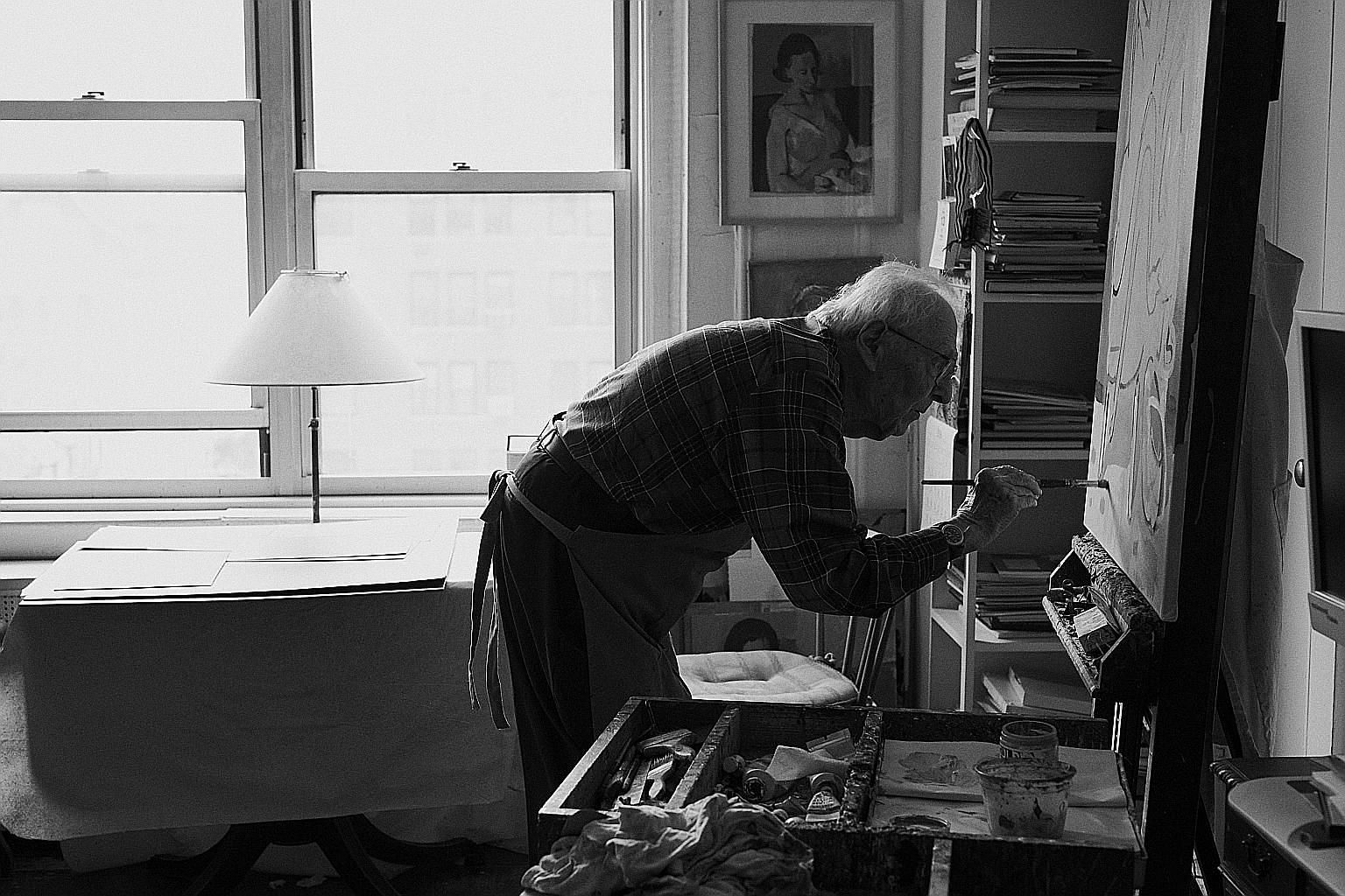 Serge Hollerbach touching up a painting in his studio in Manhattan last month. The 94-year-old has painted throughout every aspect of his vision loss caused by macular degeneration.