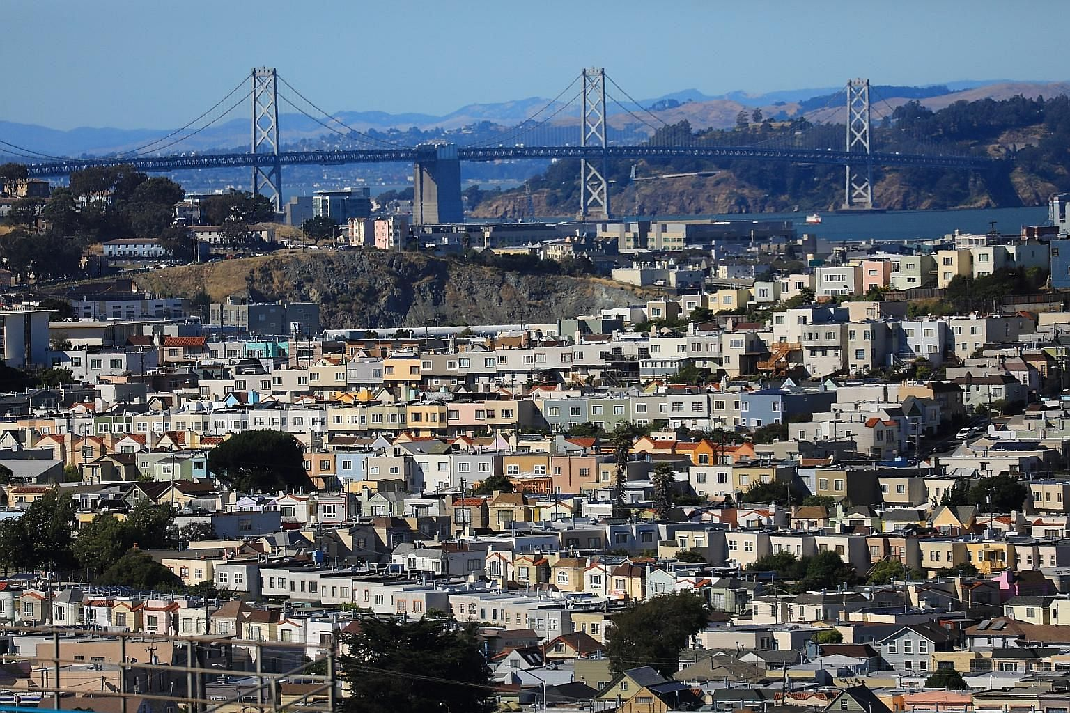 Houses near the Bay Bridge in picturesque, but prohibitively pricey, San Francisco. A family of four earning US$117,000 (S$158,800) is now classified as low income in the San Francisco area. This threshold, used to determine eligibility for federal h
