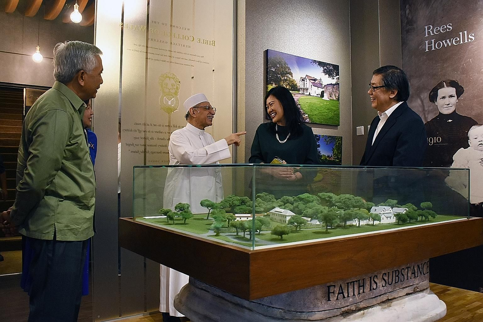 From left: Mr Hawazi Daipi, Imam Habib Hassan Al-Attas, Ms Katharyn Peh and Pastor Yang Yuck Yoong looking at a model of the Bible College of Wales during the Ba'alwie Mosque delegation's visit to Cornerstone Community Church yesterday.