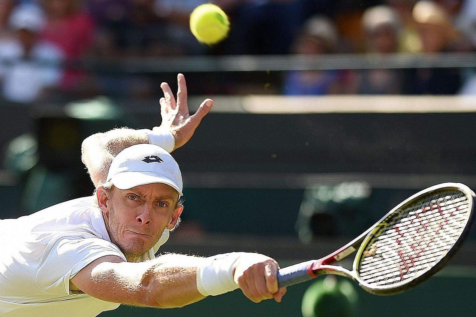 South African Kevin Anderson hitting a return against Roger Federer during his shock quarter-final win over the defending Wimbledon champion yesterday. He fought back from two sets down and even saved a match point in the third set.